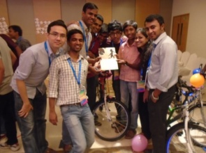 Shubham presenting a greeting card to TATA staff
