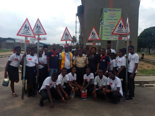 Signage for Agidingbi-students with Road officials