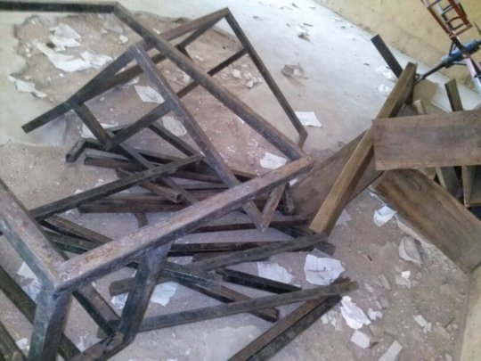 Before  - Broken furniture in abandoned classroom