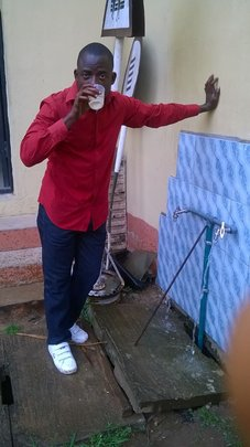 Lawal (YDTP trainer) drinking from the tap