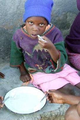 Chizani eating porridge