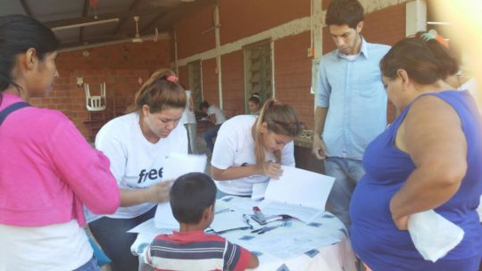 Volunteers handing out school kits!