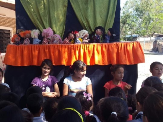 We prepared a play with puppets to bring to school