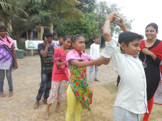 """""""Passing water"""" game during the outdoor camp"""