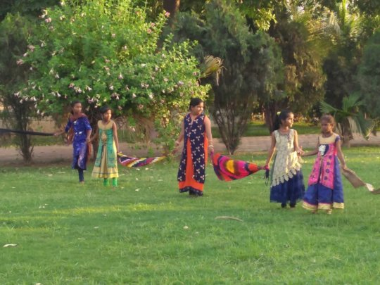 Children of Aataapi Foundation playing team game