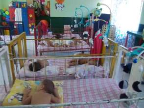 Babies sometimes have to sleep two per crib...