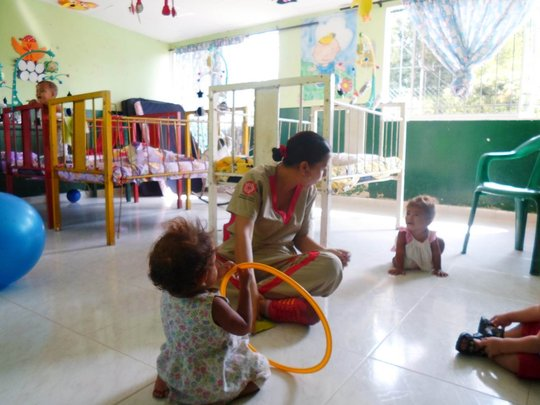 The Pivijay children and one of their caretakers