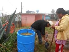 Beneficiaries preparing their own bio-fertilizer