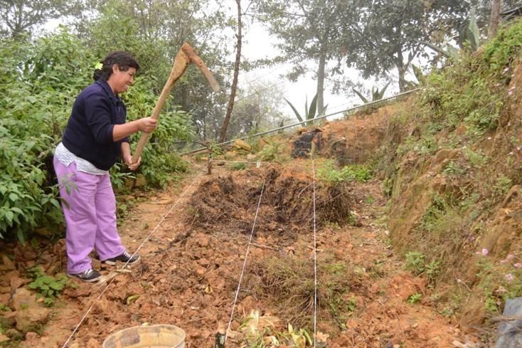 Woman working in her vegetable garden