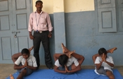 Teach YOGA to 85 at-risk Drop-out school children