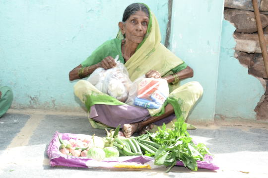Oldage woman receiving food provision adopt granny
