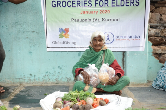elderly persons getting food groceries kit monthly