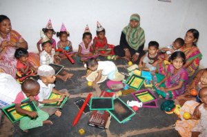 India deprived children playing with toys in care