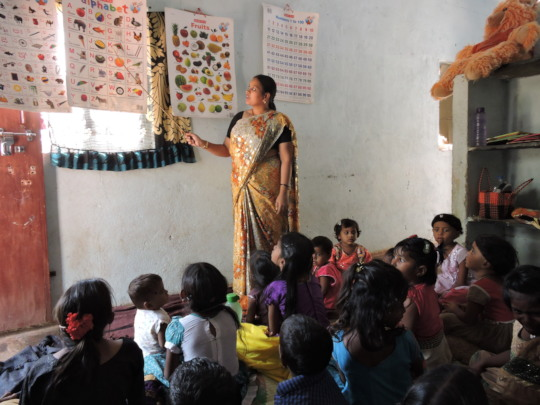 Poor Children in creches learning education from