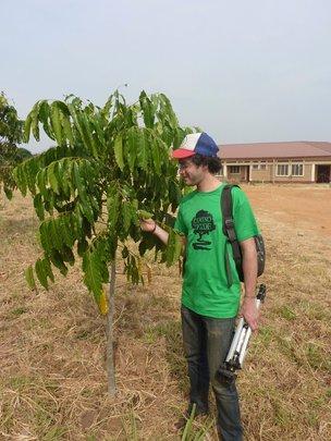 Julian Moll-Rocek with an African mahogany