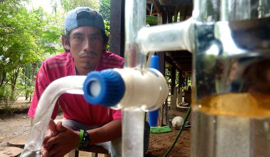 Distilling essential oil in Tambopata, Peru