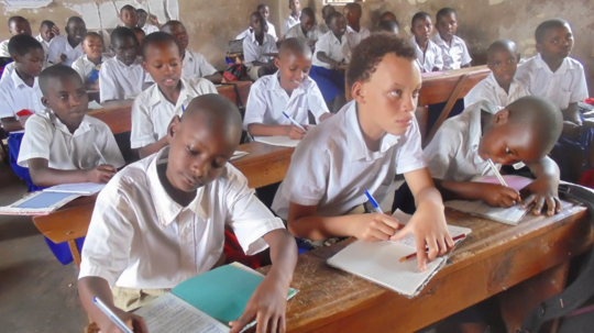 Uwase Grace (middle front) concentrates in class