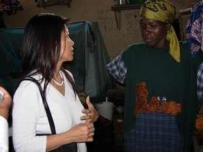 IBJ Founder Karen Tse listens to a female prisoner