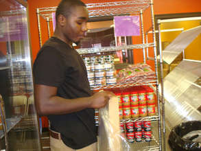 Youth intern at work in customer choice pantry