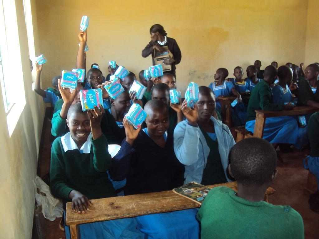 girls receiving pads in Nyaisa primary school