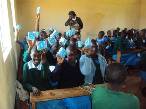 girls receiving pads in Nyaisa primary school