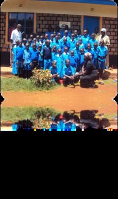 children in their new uniforms with their teachers