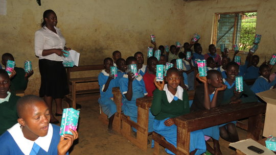 girls receiving sanitary towels