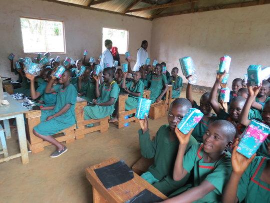 girls receiving sanitary towels