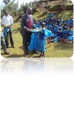 a young school girl receiving new uniform