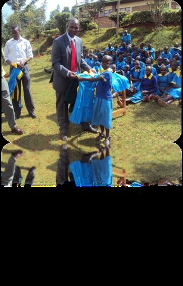 a young school girl receiving new uniform
