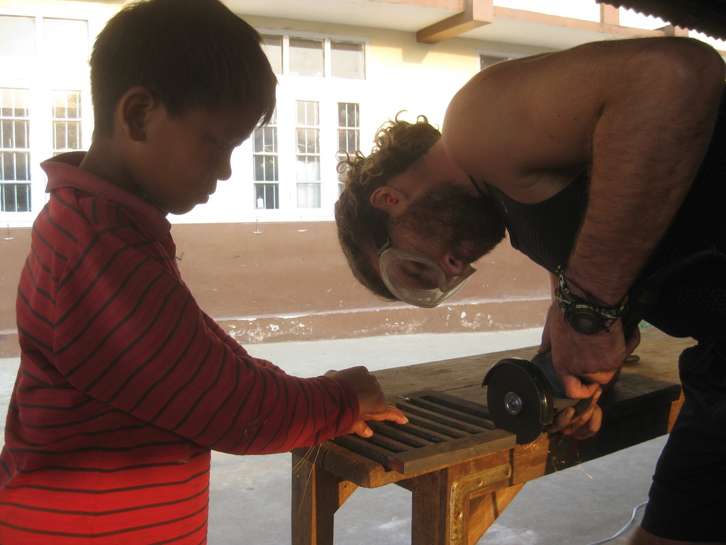 Hamish gets some help preparing the grate