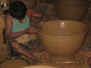 Hand-throwing a large flower pot for export