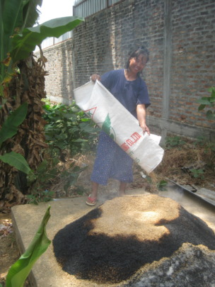 Ms Thida burns rice husks to make valuable ash