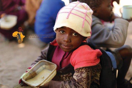 Maria eating porridge at school