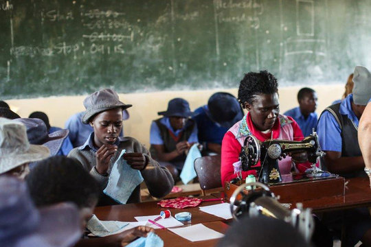 Learning how to sew kits in Zimbabwe