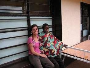 Rwanda Clinic Nancy Outside with patient