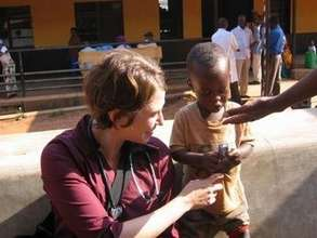 Rwanda Non-clinic Claire, Child and candy
