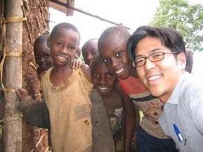 Rwanda Non-clinic Koji and boys outside