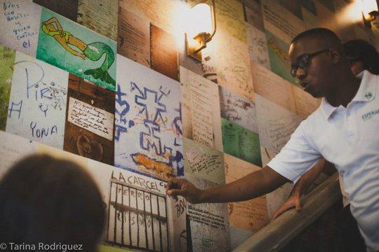 Antonio, explaining graffiti to guests