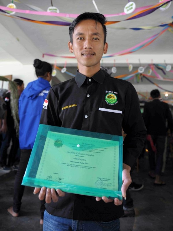 Graduate, Andre with Diploma