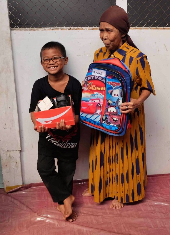 3rd Grader Bagas and his grandmother