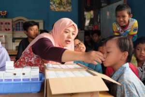 Young student gets help with medicine