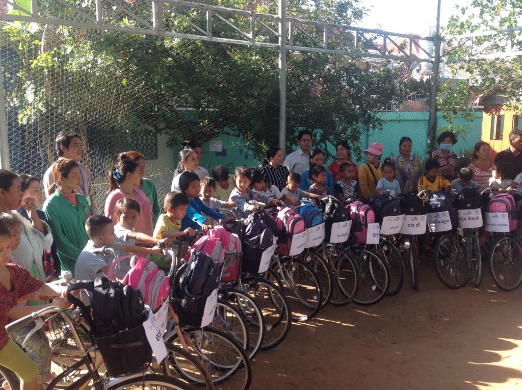 Students receiving their bikes & backpacks