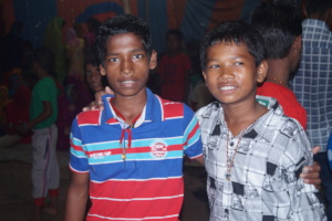 Bikash and Ishwor enjoying their new clothes