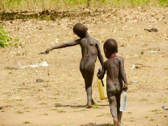 Even the smallest children help carry water
