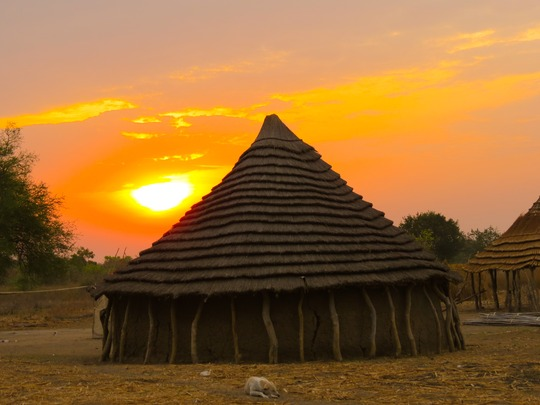 Sunset behind a tukol in South Sudan