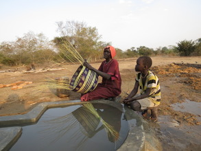 Achan, with her daughter, making basket