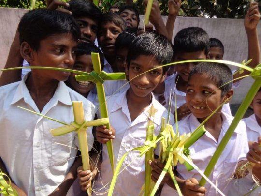children enjoyed with palm leaves