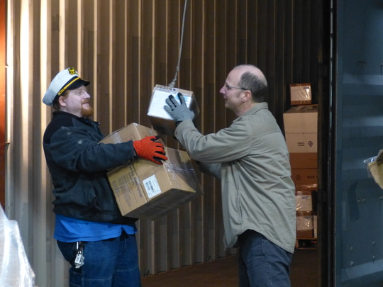 Mike and Dave load boxes for the shipment