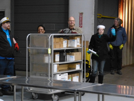 Staff double-checking inventory before loading.
